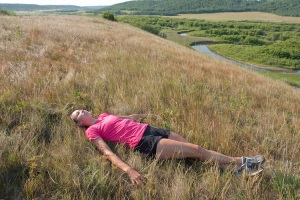 Runner-relaxing-in-grass